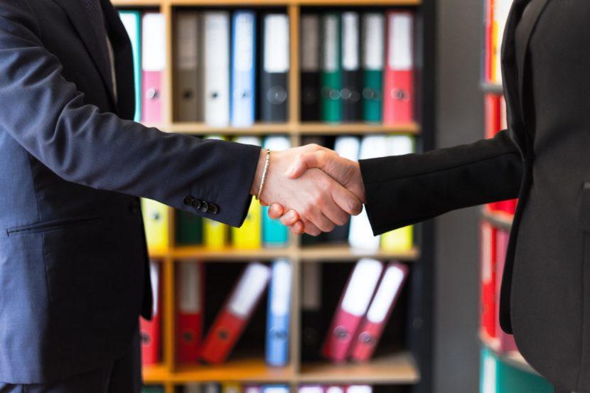 business broker raleigh shaking hands